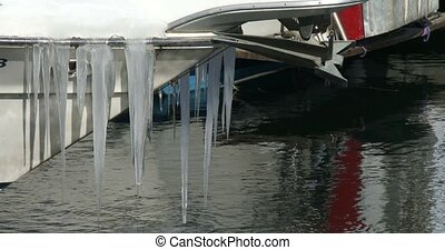 Icicles on the bow of a boat docked in downtown Toronto