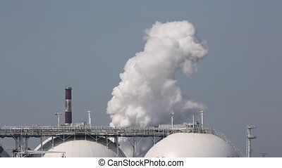Industrial plant with smoke - Industrial refinery plant with...