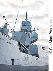 Moored naval ship with radar.