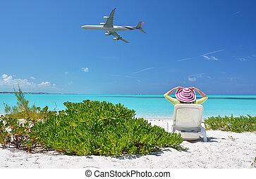 Beach scene - Girl in a striped hat on the beach of Exuma,...