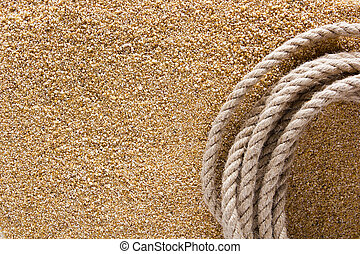 Ship thick rope on the sea sand Background for travel