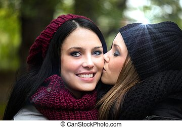 Girlfriends - two girlfriends in an autumn forest