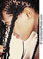 african hairstyle - young girl with traditional african...