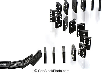 Dominoes - A stack of dominoes falling on white background...