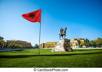 Skanderbeg square with flag and monument in the center of...
