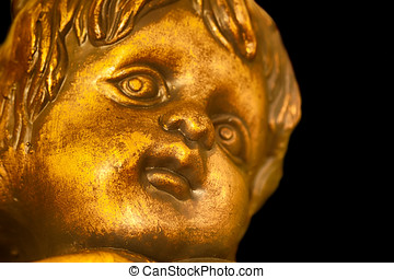 Angel - Close up of cherub with dark background