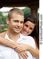 gorgeous couple - a gorgeous couple embracing and smiling