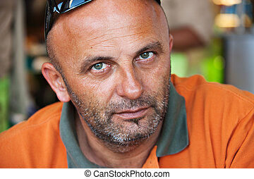 middle age man - caucasian man in his forties with orange...