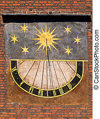 Old sundial - Detail of old sundial on church in old town in...