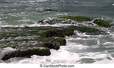 Turquoise rolling wave slamming on