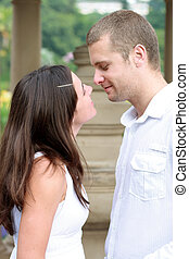 kissing couple - a couple about to kiss in the garden