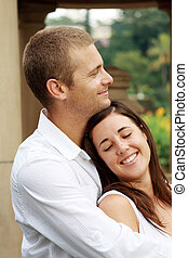 couple - a couple smiling and embracing outdoors