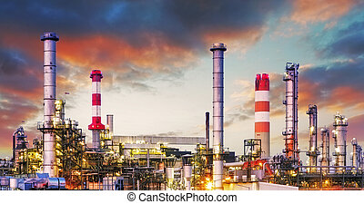 Oil refinery at dramatic twilight