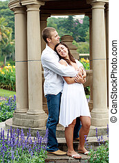 loving couple - a loving girlfriend leaning against her...