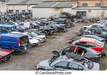 unnecessary cars - Auto dump which kept crushed between cars