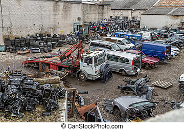 scrap-iron - Auto dump which kept crushed between cars
