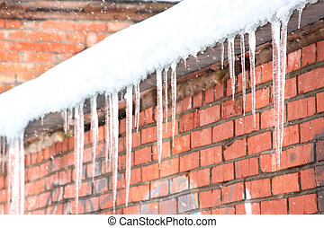 Icicles on a brick wall