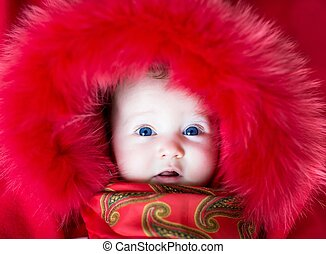 Baby in a winter jacket - Beautiful baby girl with big blue...