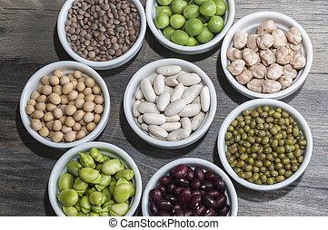 Vegetables - Varios boles de ceramica con legumbres crudas