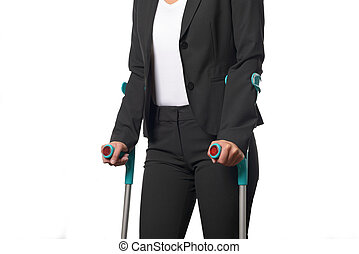 Disabled Businesswoman Walking with Two Crutches - Disabled...