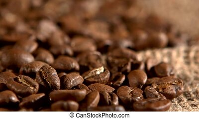 Coffee beans on burlap sacking background and dynamic change...