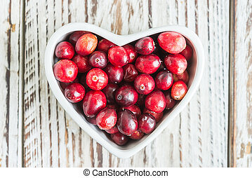 Cranberry on wooden background