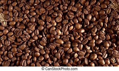 Coffee beans on burlap sacking, background with fleeting...