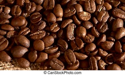 Coffee beans on burlap sacking, background, close up,...