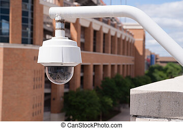 Video Security Camera Housing Mounted High on College Campus...