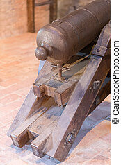 power of the past - old cannon inside a medieval castle
