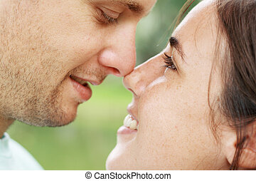 intimate couple - an intimate couple with their faces close...