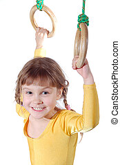 girl on gymnastic rings - little smiling girl on gymnastic...