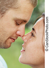 loving couple - a loving couple staring at each other about...