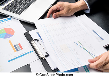 businessman looking charts and graphs results