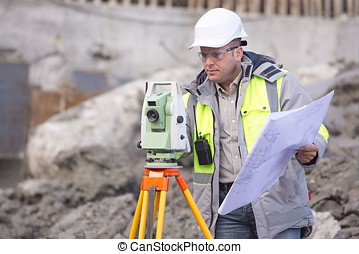 Surveyor At Consruction Site - Surveyor at at construction...