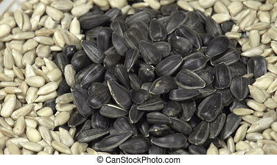 Sunflower Seeds - Sunflower seeds in the black peel lie in...