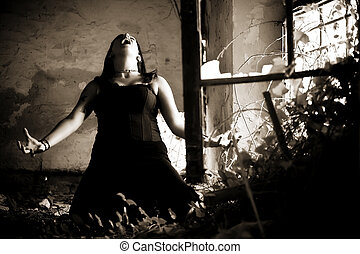 Dramatic screaming scene - Young gothic woman in a dramatic...