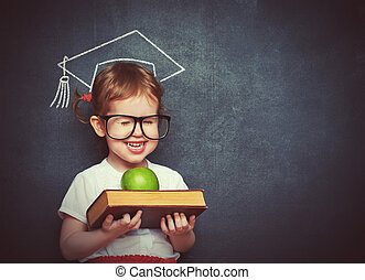 girl schoolgirl with books and apple in a school board -...