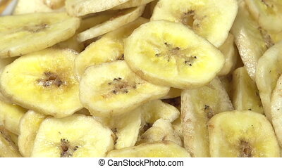 Banana Chips - Plate with banana chips rotates the camera