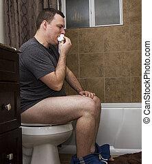 man eating toilet paper - very disgusting man eating his...