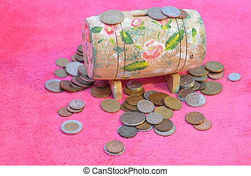 Money box - Golden coins and wooden money box, on pink...