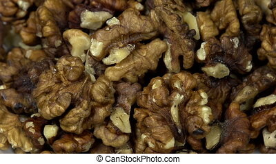 Shelled Walnuts - Front of the camera rotates plate with...