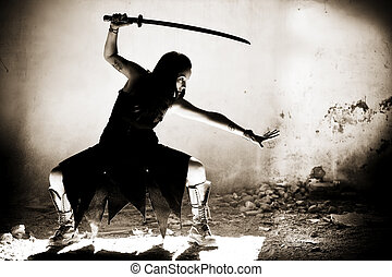 Female warrior - Female gothic warrior posing with katana...