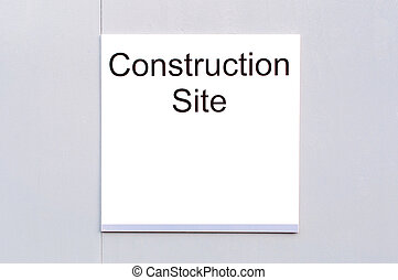Sign Construction Site on wooden background