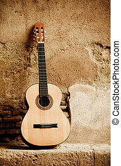 Classic guitar on wall - Spanish guitar on old wall