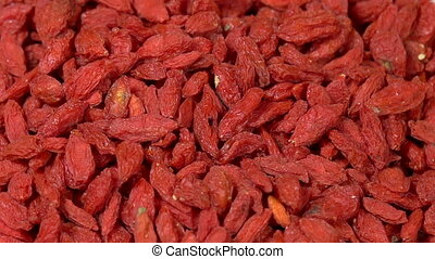 Dried Goji Berries - Front of the camera rotates plate with...