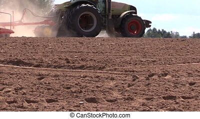 tractor fertilize soil - Agriculture tractor working in...