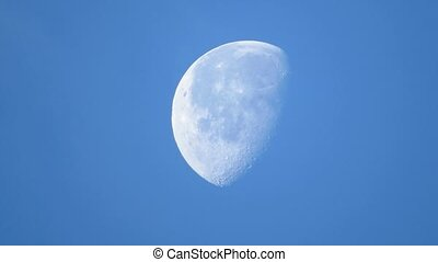 Moon on the background of blue sky