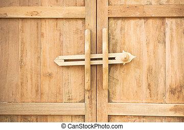 Ancient door latch Traditional ancient wooden door latch.