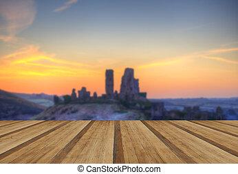 Corfe Castle Winter sunrise pre-dawn colourburst with wooden...